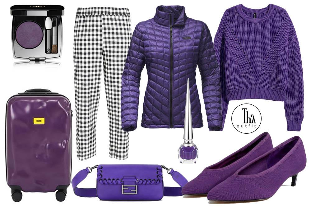 Outfit ispirato al colore dell'anno 2018, l'Ultra Violet PANTONE 18-3838. Pullover H&M, pantalone a quadri su Yoox, piumino viola termoisolante North Face, scarpe col tacchetto Stradivarius su ASOS, borsetta in pelle di vitello Fendi dal sito Nordstrom, ombretto vibrant violet Chanel, smalto ultra violet Louboutin, trolley dal sito dal sito Luisaviaroma