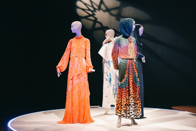 """Installation of """"Contemporary Muslim Fashions"""" on view at the de Young museum from September 22, 2018 - January 6, 2019 Ensembles by Peter Pilotto, and Mary Katrantzou, Yves Saint Laurent and Rebecca Kellett. Photography by Joanna Garcia Cheran Image courtesy of the Fine Arts Museums of San Francisco"""